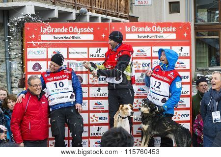 TERMIGNON VANOISE FRANCE - JANUARY 20 2016 - Podium Remy COSTE the winner of the GRANDE ODYSSEE the hardest mushers race the 2nd Jimmy PETTERSSON and 3th named Jean-Philippe PONTHIER Vanoise Alps