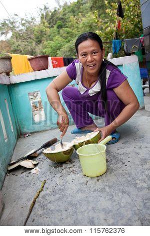 Asian women is preparing a coconut