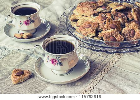 Two Cups Of Coffe With Cookies