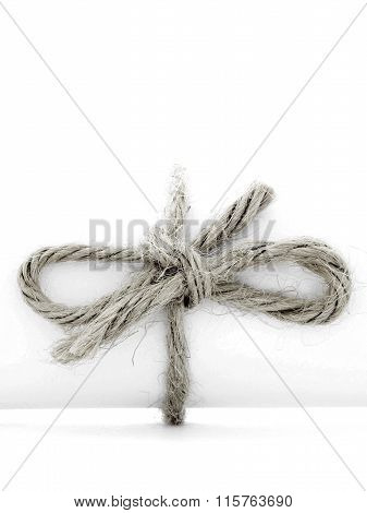 Handmade Natural String Node Tied On White Message Package Isolated