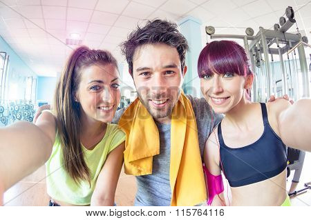 Happy Active Friends Trio Taking Selfie In Gym Training Studio Center - Sporty Fitness People