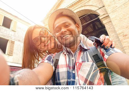Multiracial Couple Taking Selfie At Old Town Trip - Fun Concept With Alternative Fashion Travelers