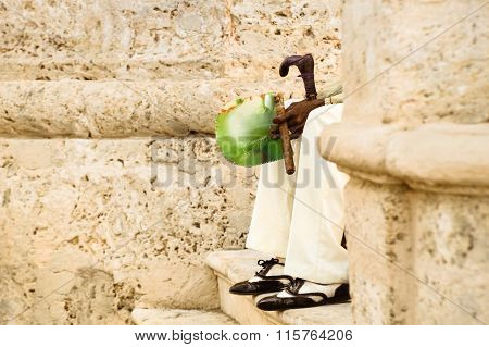 Detail Of Unrecognizable Person With Cuban Cigar Sitting On Stairs At Havana Old City In Cuba - Indi