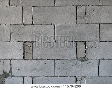 Raw AAC autoclaved aerated concrete wall, front view, editable background.
