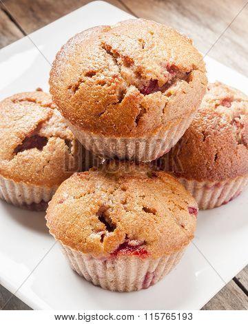 homemade strawberry and orange muffins close up