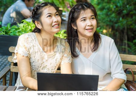 Asian Businees Women Enjoying With Her Friend On Laptop