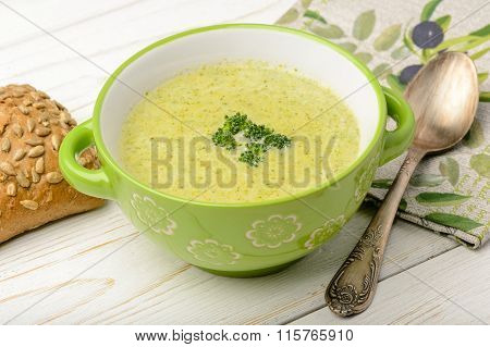 Broccoli cream soup on the wooden table.