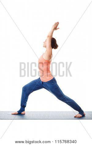 Beautiful sporty fit yogini woman practices yoga asana Virabhadrasana 1 - warrior pose 1 (beginner variation)  isolated on white