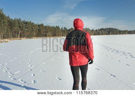 Man runner during outdoors winter race