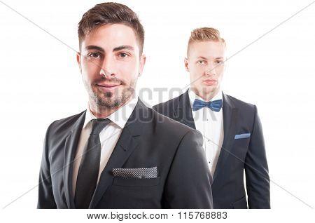 Portrait Of Elegant Business Men Wearing Necktie And Bowtie.