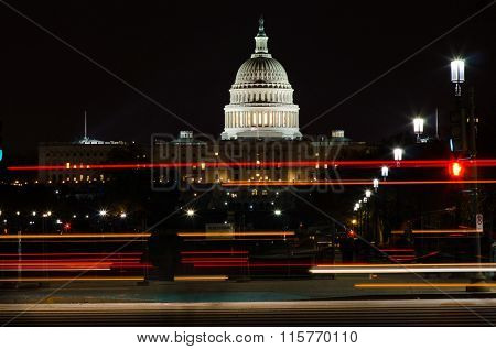 Washington DC in the night - US Capitol Building with car lights trails foreground