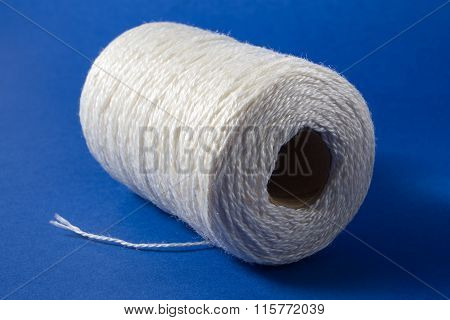 White thread isolated on white background. Rope, wool, knitting homemade handmade object.