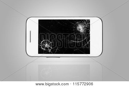 Smartphone with broken screen on graphical background