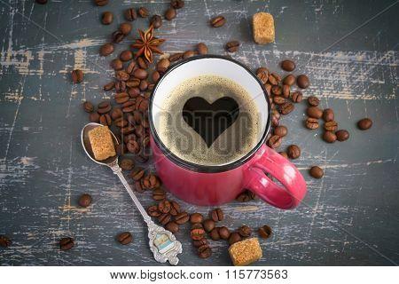 Espresso Mug With A Heart Of Crema On Vintage Background