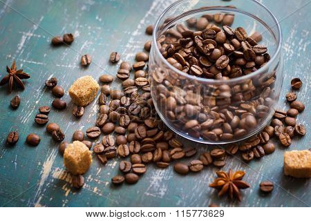 Coffee Beans In Jar And Loose On The Old Shabby Background