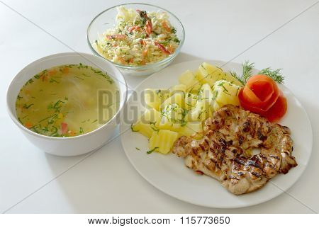 Menu Grilled chicken breast with boiled potatoes, dill, tomato chicken soup, White cabbage salad