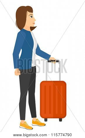 Woman standing with suitcase.