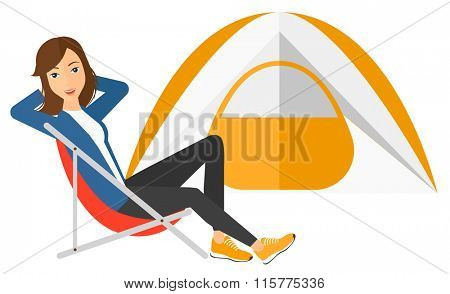 Woman sitting in folding chair.