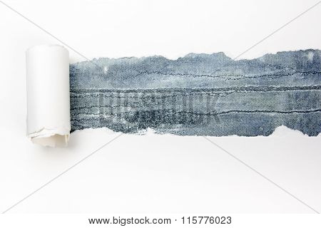 Ripped paper, space for copy. Blue background.