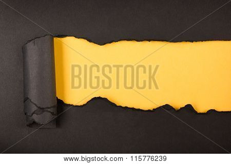 Ripped paper, space for copy. Black and yellow background.