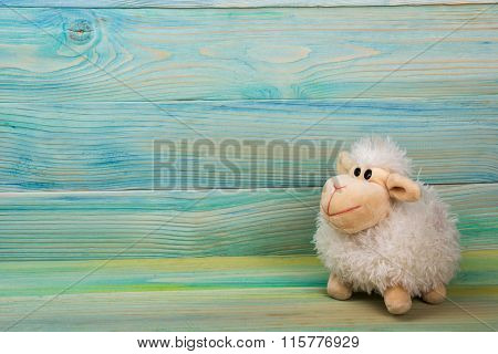 Home interior. Childhood. Blue background. Toy sitting on a couch. Copy space.