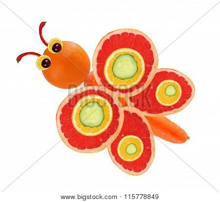 Creative Food Concept. Funny Little Butterfly Made Of Fruits And Vegetables.