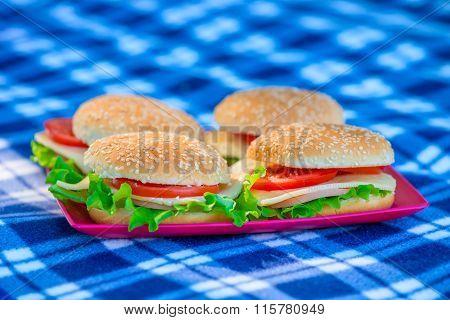 Four Cheeseburger Closeup On A Plaid