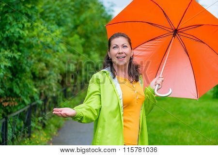 Bright Girl With An Umbrella On A Rainy Day On The Walk