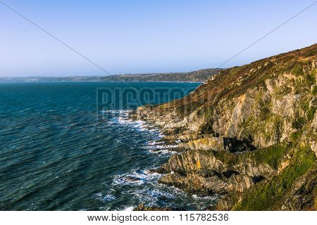Rocky Coastline And Ocean Waves In Cornwall, Uk