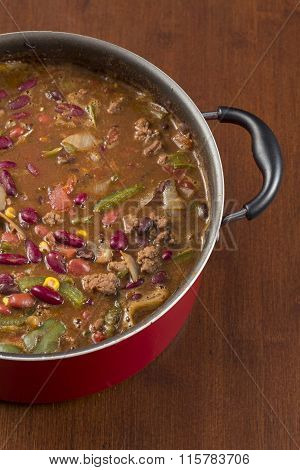 Hot and spicy Chili con carne in a large red pot