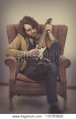 Musician Playing Electric Ukulele