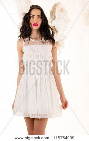 attractive woman in a white dress in the clouds