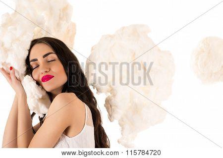 beautiful woman sleeping on the clouds