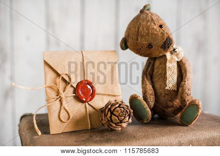 Teddy bear on a suitcase with love messages