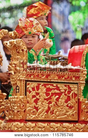Little Child Playing Music On Balinese Gamelan