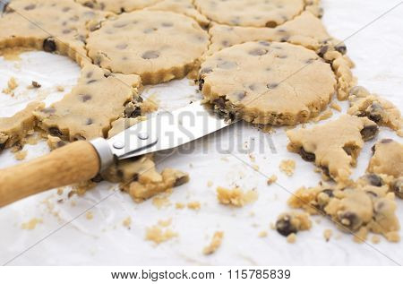 Palette Knife Lifting Cookies From Kitchen Worktop