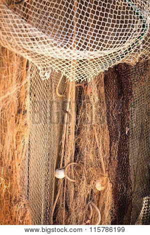 Old Fishing Net In The Harbor With Cork Floats