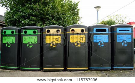 Recycling bins in a row