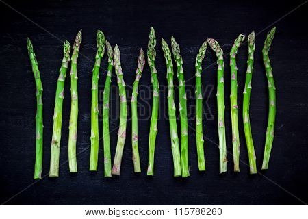 Asparagus On Black Wood, Top View