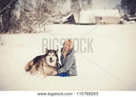 Cute Woman In A Sweater Sitting With Dog