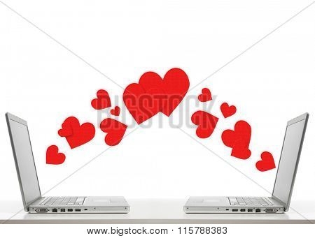 Love communication. Two laptops opposite to each other exchange hearts, isolated on white