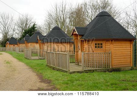 Wooden cabins in a park
