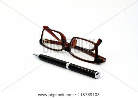 Black Pen And Brown Glasses Isolated On White Background