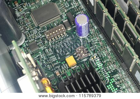 Motherboard With Microcircuits. Ram, Processors And Radiator