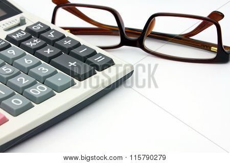 Calculator And Glasses Isolated On White Background