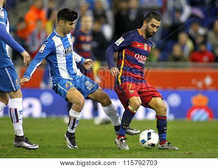 BARCELONA - JAN, 13: Marco Asensio(L) of RDC Espanyol vies with Arda Turan(R) of FC Barcelona during a Spanish Cup match at the Power8 stadium on January 13, 2016 in Barcelona, Spain