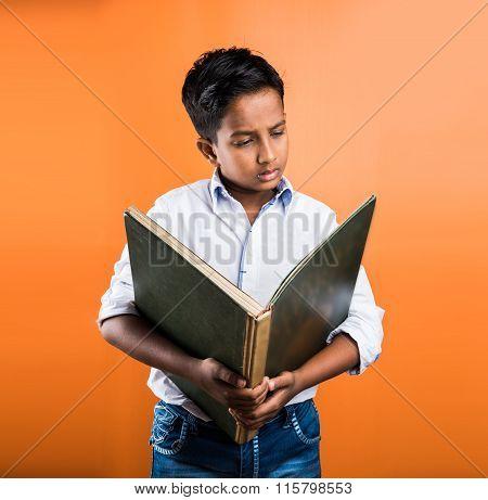 Indian kid enjoying reading book, asian kid reading book, african kid reading book, indian kid study