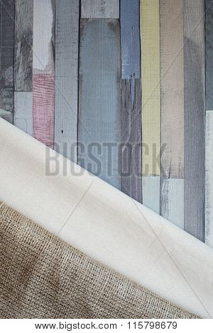 Linen And Burlap Tablecloth On Corner A Wooden Table.