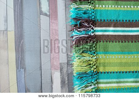 Green Striped Tablecloth On The Wooden Table.