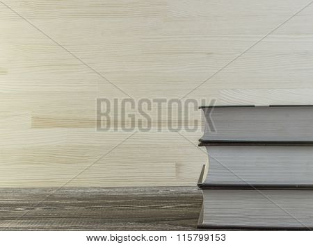 Closed Books On A Corner Of Wooden Table